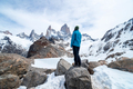 A hiker woman with a blue jacket on the base of Fitz Roy Mountain in Patagonia, Argentina - PhotoDune Item for Sale
