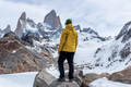 A hiker with a yellow jacket on the base of Fitz Roy Mountain in Patagonia, Argentina - PhotoDune Item for Sale