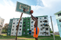 Young African American Man Playing Basketball On Outdoor Court in Cuba - PhotoDune Item for Sale