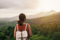 Young woman traveler looking at sunset over the mountain - PhotoDune Item for Sale