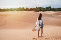 Young woman traveler walking at red sand dunes in Vietnam, Travel lifestyle concept - PhotoDune Item for Sale