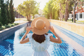 Young woman relaxing at swimming pool, Summer vacation concept - PhotoDune Item for Sale