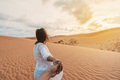 Young couple traveler looking beautiful landscape at red sand dunes - PhotoDune Item for Sale
