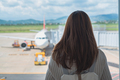 Young woman traveler looking at the airplane at the airport, Travel concept - PhotoDune Item for Sale