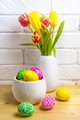 Easter centerpiece with pink, green, yellow eggs and tulips - PhotoDune Item for Sale