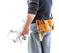 Construction Worker and Drone Pilot With Toolbelt Holding Drone Isolated on White Background - PhotoDune Item for Sale