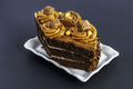 Chocolate cake. A slice of chocolate cake on a gray background - PhotoDune Item for Sale