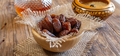 bowl of dried sweet dates on wooden table - PhotoDune Item for Sale