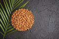 Composition of Whole almond nuts in black plate placed on black stone table - PhotoDune Item for Sale