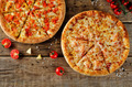 Pizza with cheese, tomato sauce and fresh tomatoes on a wood background - PhotoDune Item for Sale