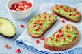 Smashed avocado pomegranate rye sandwiches - PhotoDune Item for Sale