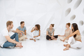 Groups of different people sitting and talking together. Social concept - PhotoDune Item for Sale