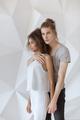 Interracial romantic fashionable couple in studio - PhotoDune Item for Sale