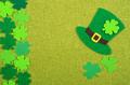 Flat lay Happy St. Patrick's background mockup of handmade felt shamrock clover leaves - PhotoDune Item for Sale