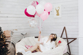Beautiful happy bride with pink air balloons in cozy arm-chair - PhotoDune Item for Sale