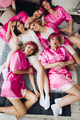 Funny girlfriends in pink robes with bride-to-be - PhotoDune Item for Sale