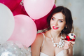 Smiling bride-to-be with muffin at her hen party - PhotoDune Item for Sale