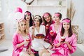 Pretty girls in pink robes and sleep masks with desserts at bridal showers - PhotoDune Item for Sale