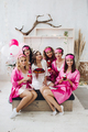 Bridesmaids with cupcakes and bride-to-be with cake - PhotoDune Item for Sale