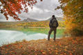 Man standing alone on the autumn pond. - PhotoDune Item for Sale