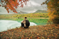 Man sitting alone on the pond. - PhotoDune Item for Sale