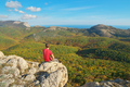 Man sitting on the edge of mountain - PhotoDune Item for Sale