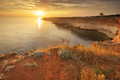 Sunset on sea cliffs. - PhotoDune Item for Sale