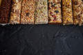 Row of mixed gluten free granola cereal energy bars. With dried fruits and nuts - PhotoDune Item for Sale
