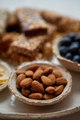 Close up of whole Almonds. With various energy nutrition bars in background - PhotoDune Item for Sale