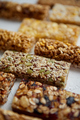 Close up on healthy granola fit bars arragement. Placed on white table - PhotoDune Item for Sale