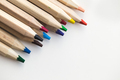 Wooden colorful ordinary pencils on a white background - PhotoDune Item for Sale