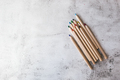 Wooden colored pencils on the gray background - PhotoDune Item for Sale