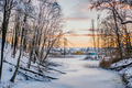 Frozen River By Bare Trees Against Sky - PhotoDune Item for Sale