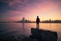 Man looking on cityscape at colorful dawn - PhotoDune Item for Sale