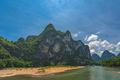 Nine Horse Mural Hill landmark peak on the shore of Li river - PhotoDune Item for Sale