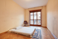 Bedroom with tatami bed and armchair in old apartment - PhotoDune Item for Sale