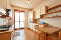 Kitchen interior with wooden table in a sunny day in normal apartment - PhotoDune Item for Sale