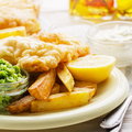 Traditional British street food fish and chips with tartar sauce and mushy peas on paper plate - PhotoDune Item for Sale