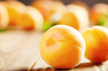 Ripe organic apricots on wooden table closeup view - PhotoDune Item for Sale