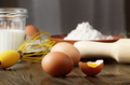 Raw organic brown chicken broken eggs with yolk flour milk and whisk on kitchen wooden table - PhotoDune Item for Sale