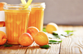 Apricot smoothie in mason jar on wooden table - PhotoDune Item for Sale