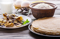 French crepes with chocolate sauce walnuts eggs and flour on wooden kitchen table - PhotoDune Item for Sale