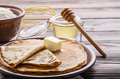 French crepes with butter flour and honey in ceramic dish on wooden kitchen table - PhotoDune Item for Sale