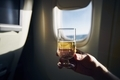 Glass of sparkling wine during flight - PhotoDune Item for Sale