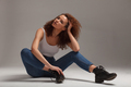 casual clothing mixed race curly woman on gray background - PhotoDune Item for Sale