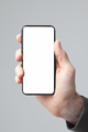 modern smart phone in male hand on gray background - PhotoDune Item for Sale