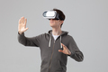 guy using VR goggles isolated on gray background - PhotoDune Item for Sale
