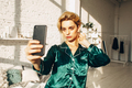 fashion female model in green silk pajamas doing selphie - PhotoDune Item for Sale
