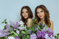 Studio fashion portrait photo of two twins women with a bouquet of spring flowers - PhotoDune Item for Sale