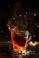 Splash in glass cup of black tea - PhotoDune Item for Sale